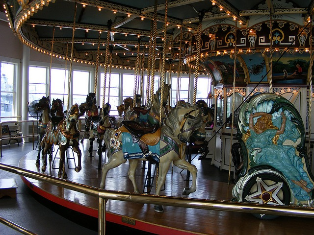 Carved carousel horses in merry-go-round inside pavilion - Fall River MA