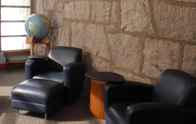 Comfortable blue leather chairs - library reading room with globe