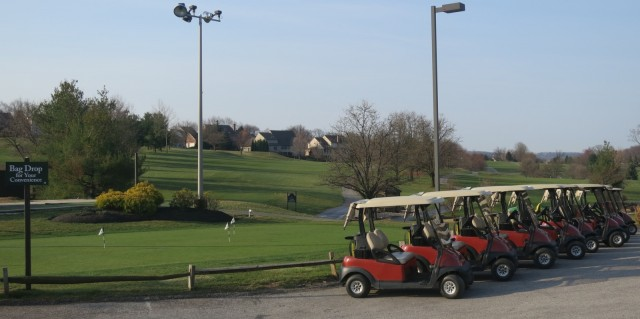 Golf carts lined up to go on green undulating golf course in York, PA