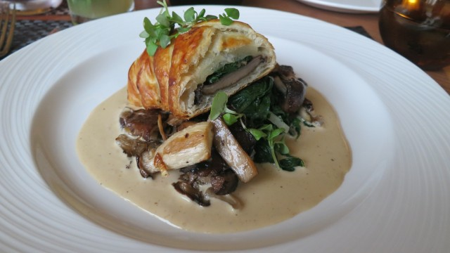 Golden brown pastry stuffed with seasoned wild mushrooms