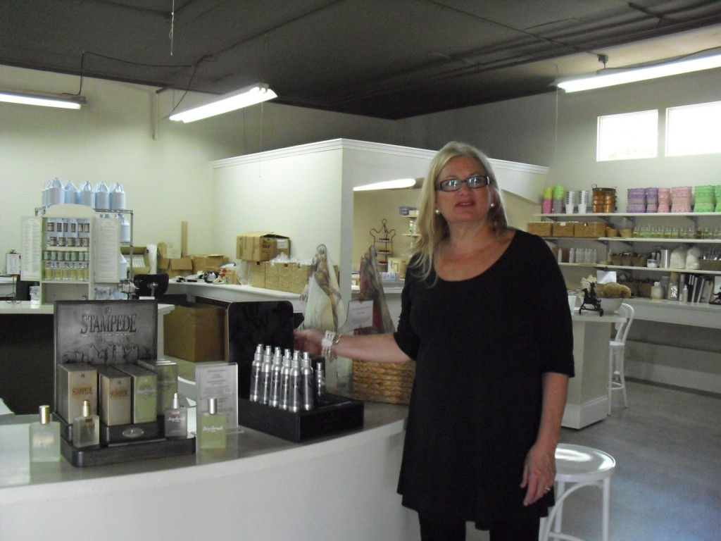 Owner of only perfumery in the US with operations under one roof standing in her factory