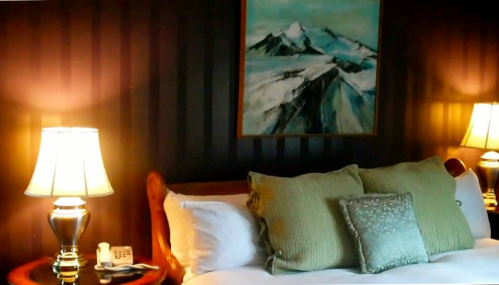 luxury bedding and side-table lamps lit at luxury B&B. Belfry Inne and Bistro, Sandwich, MA