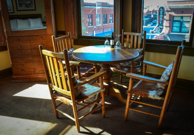 Table and chairs and view of street from Bonnie and Clyde Suite at Stockyards Hotel in Fort Worth, Texas