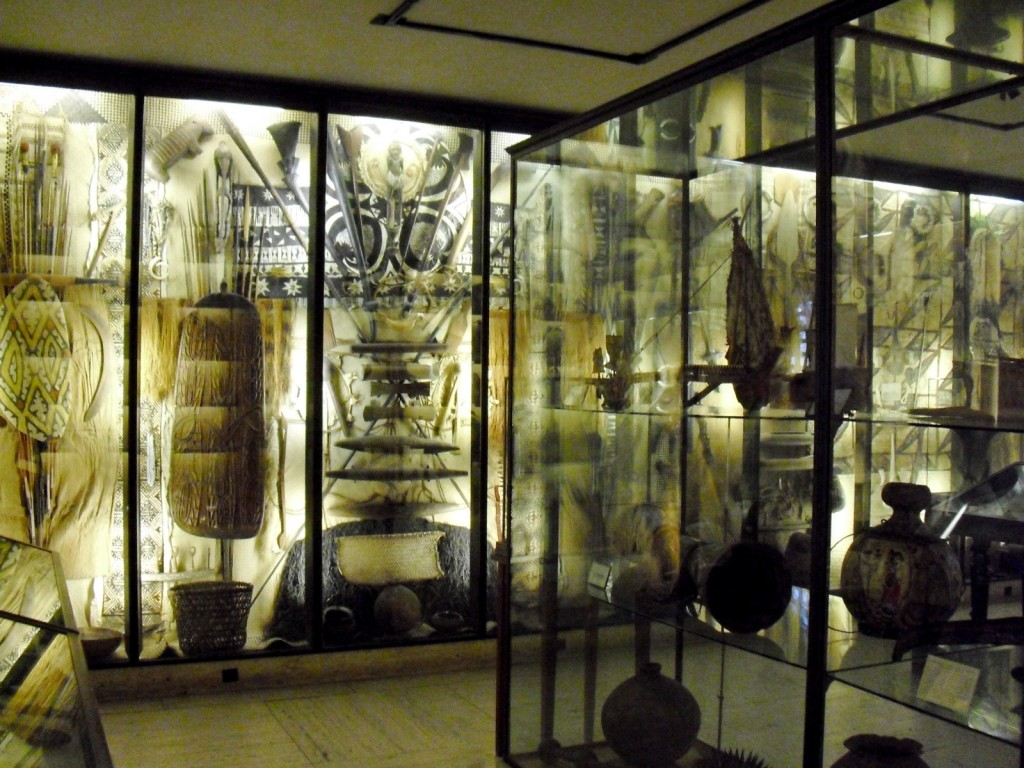 Back-lit glass cases filled with exotic artifacts from around the world