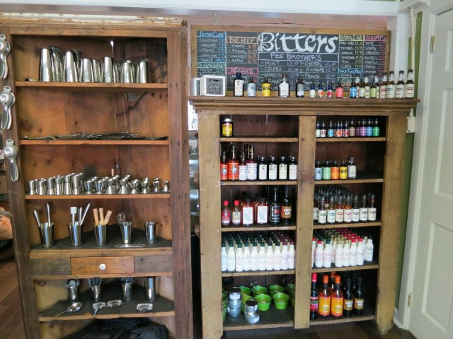 Shelves of bar tools and selection of bitters at a shop in Beacon, NY