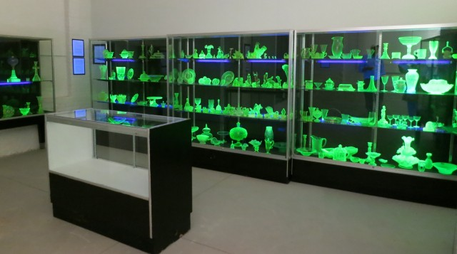 Vaseline Glass made with uranium glows green under ultraviolet light at New Bedford Museum of Glass