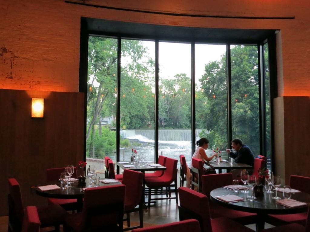 Dining by window overlooking waterfall and Fishkill Creek, Beacon, NY