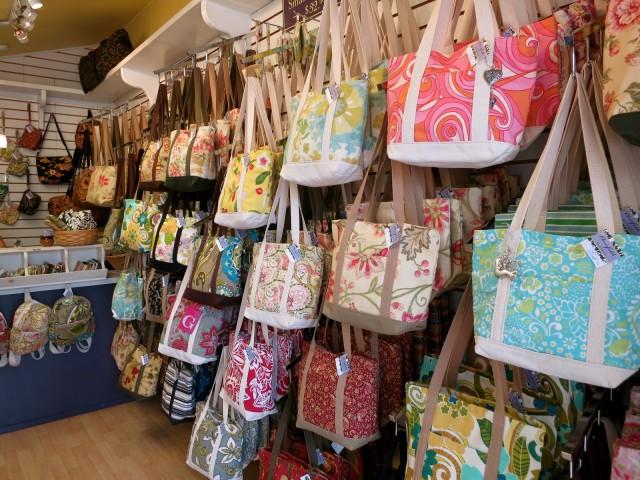 Racks of colorful handmade women's handbags in Lancaster County PA