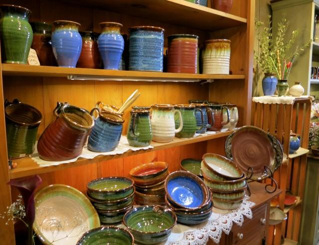 Vibrantly colored pottery line shelves in Kitchen Kettle Village