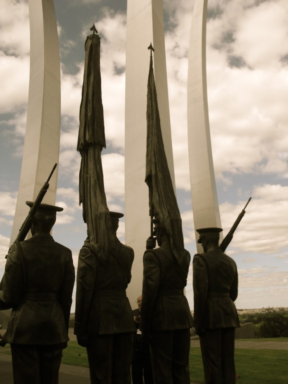 Sculpture of Four Honor Guards Stand Sentry in Foreground of Air Force Memorial Spires Arlington, VA
