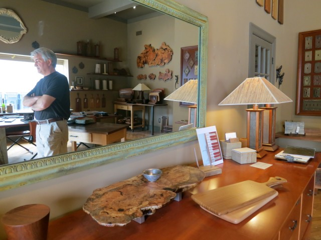 John Luttman reflected in a mirror in his table-wares gallery - just off his studio in Phoenixville, PA