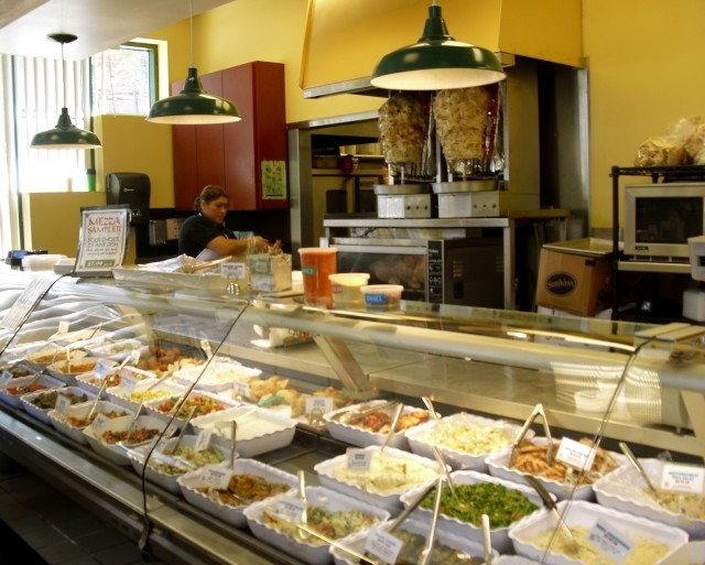 An array of gourmet Middle Eastern salads and foods in Lebanese Taverna Market, Arlington VA