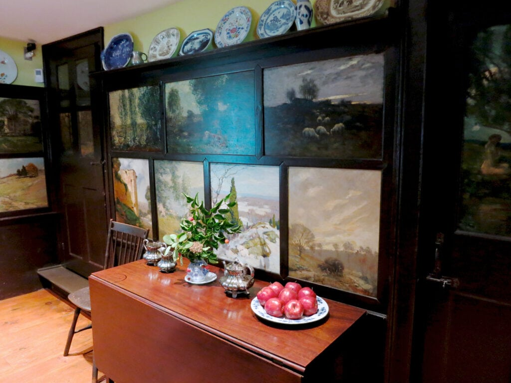 Impressionist art on dining room panels at Florence Griswold Home and Museum Old Lyme CT