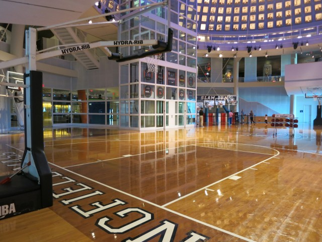 Visitors shoot hoops on large court at the Basetball Hall of Fame in Springfield MA