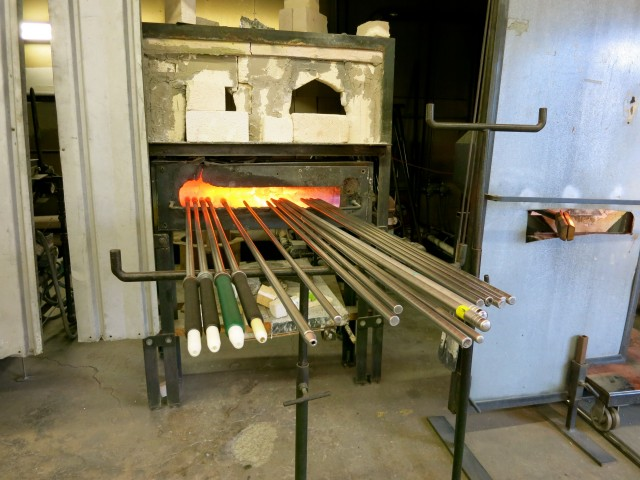 Hollow and solid pipes await glass artists at Diablo Glass School, Boston MA