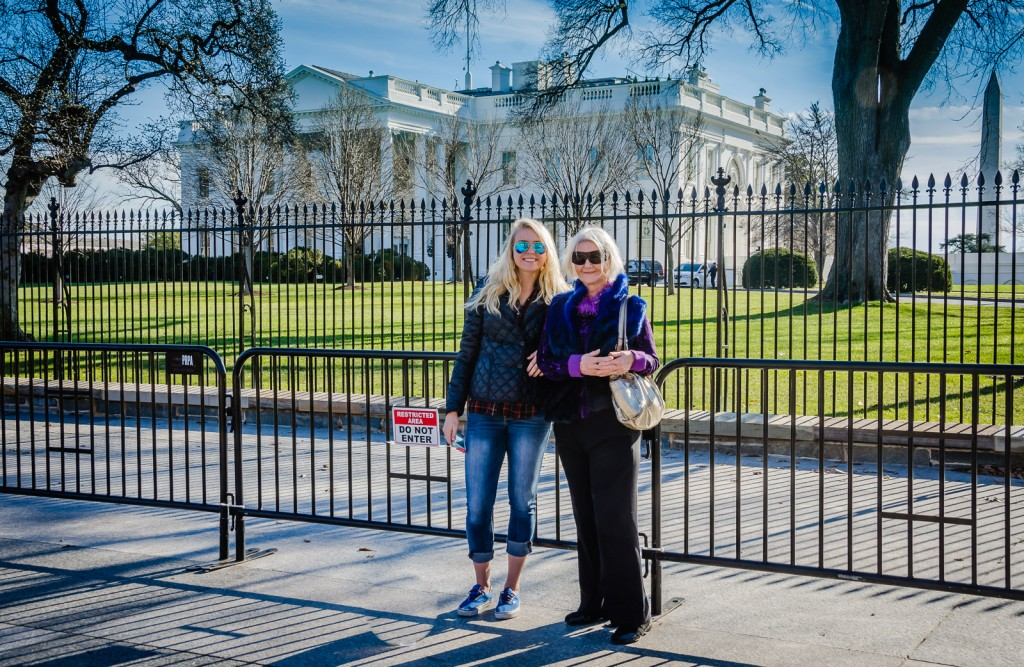Teenage girl and grandmother pose in front of White House and Washington Monument.