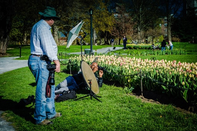 Richard Mitchell, of Ethereal Shooter Photography, casts a warm glow on tulips with a golden diffuser. Michael Boettcher, of Desdelan Photography, looks on. #photography #garden @GetawayMavens