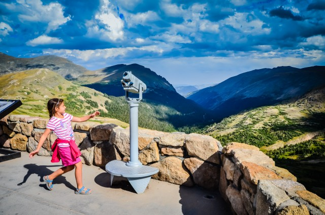Young girls runs to lookout at Alpine Visitor Center, the highest facility of its kind, in Rocky Mountain National Park, Colorado.