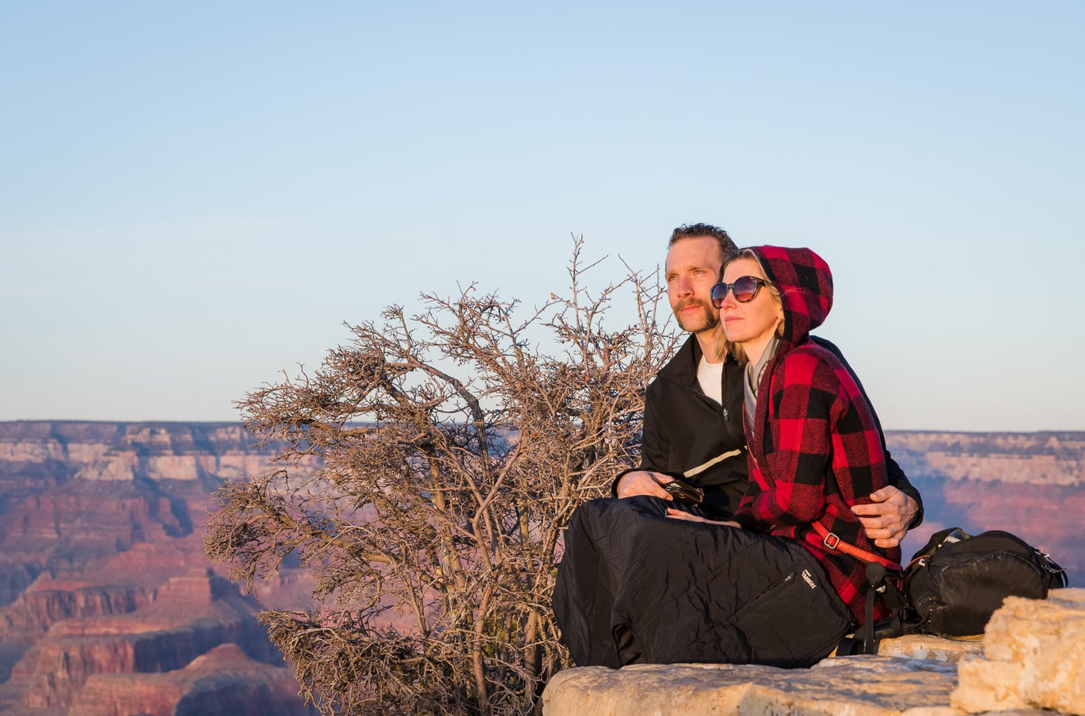 Couple admires Grand Canyon sunset.