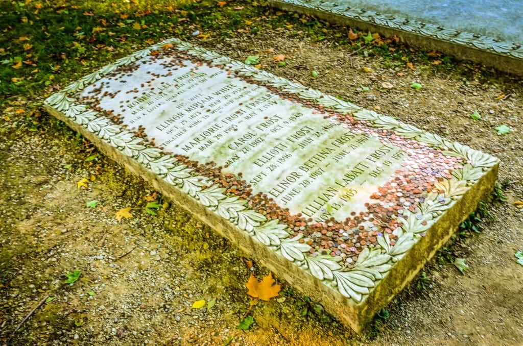 Copper pennies on the gravesite of poet Robert Frost