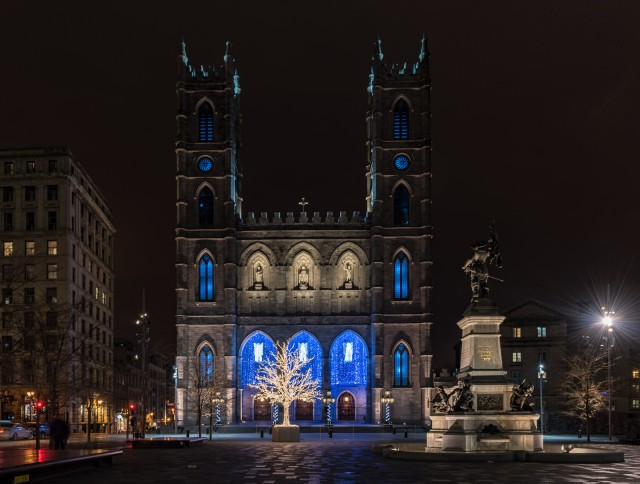 Notre-Dame Basilica lit up at night in Old Montreal, Quebec.