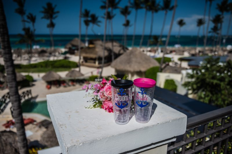 Bride and Groom Cups and flower bouquet at Now Larimar Resort in Punta Cana, Dominican Republic.