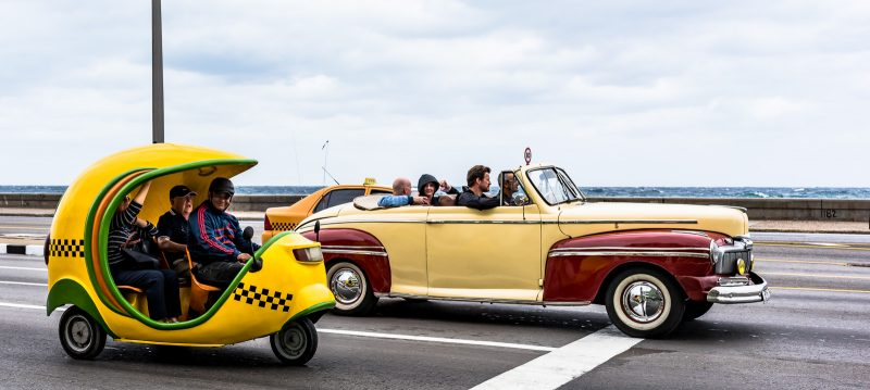 Cocomobil and Vintage Car on Malecon - Havana, Cuba
