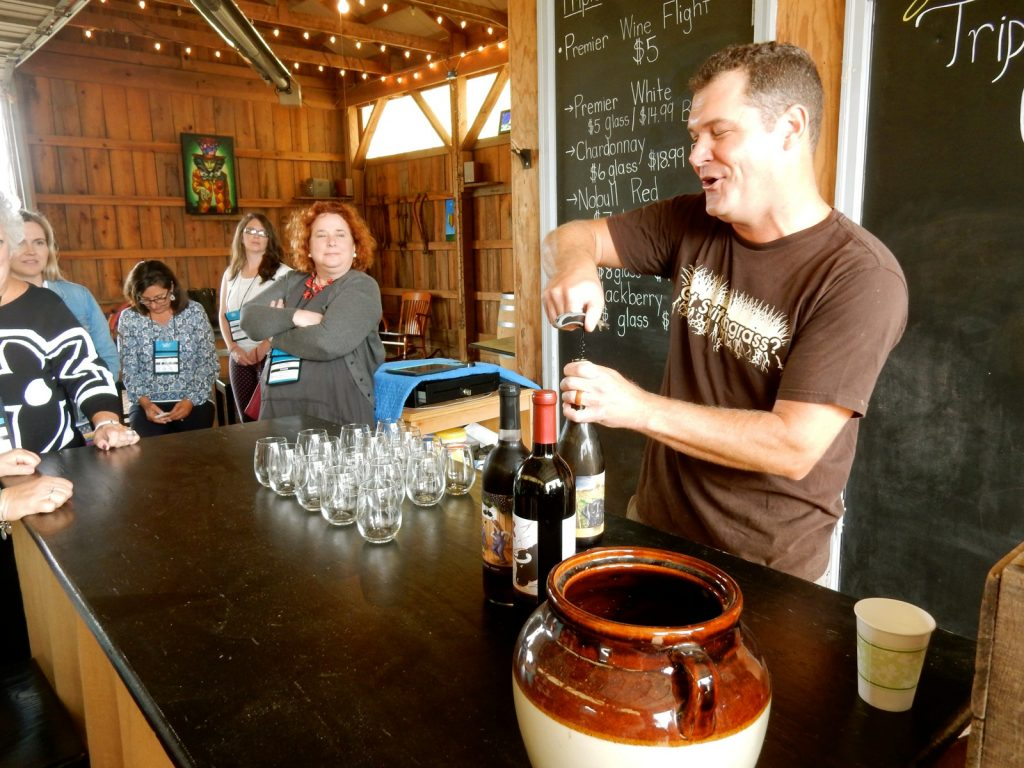 Wine pour at Triple Creek Winery