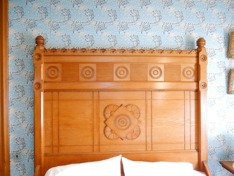 frank-furness-fan-headboard-with-matching-wallpaper-physick-estate-cape-may-nj