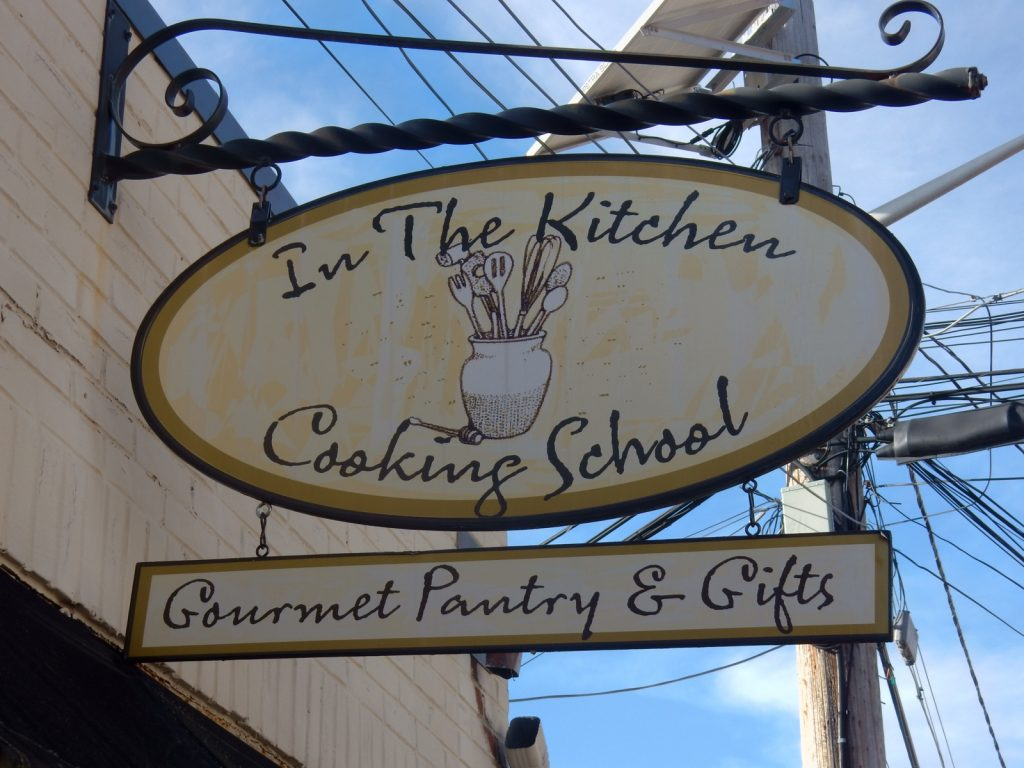 In The Kitchen Cooking School sign