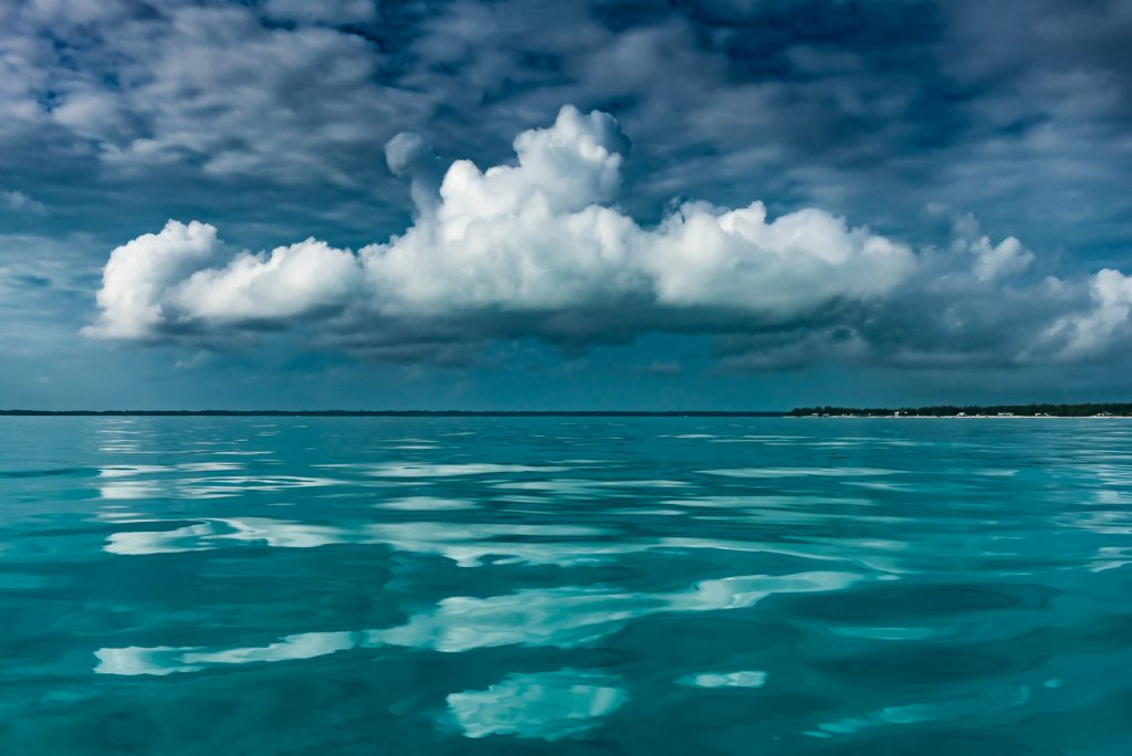 Reflection of cloud on crystal clear ocean in the Abaco Islands