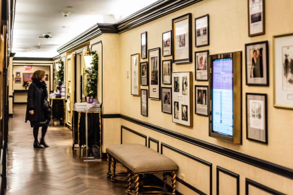 Woman eyes entrance to BG Restaurant in Bergdorf Goodman store.