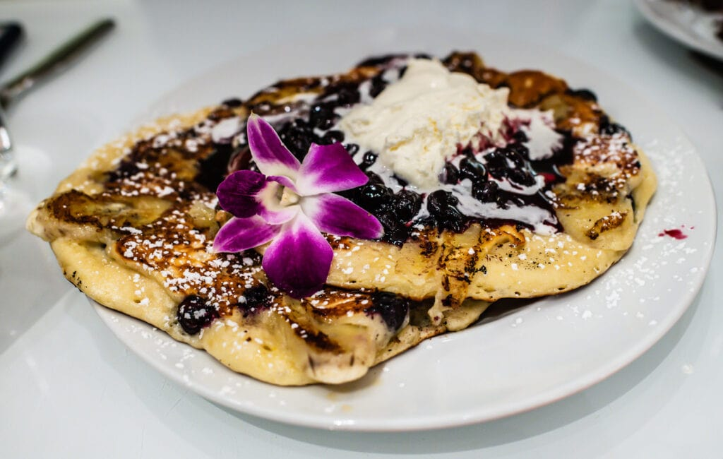 Blueberry pancakes served at Normas Restaurant at Parker New York Hotel
