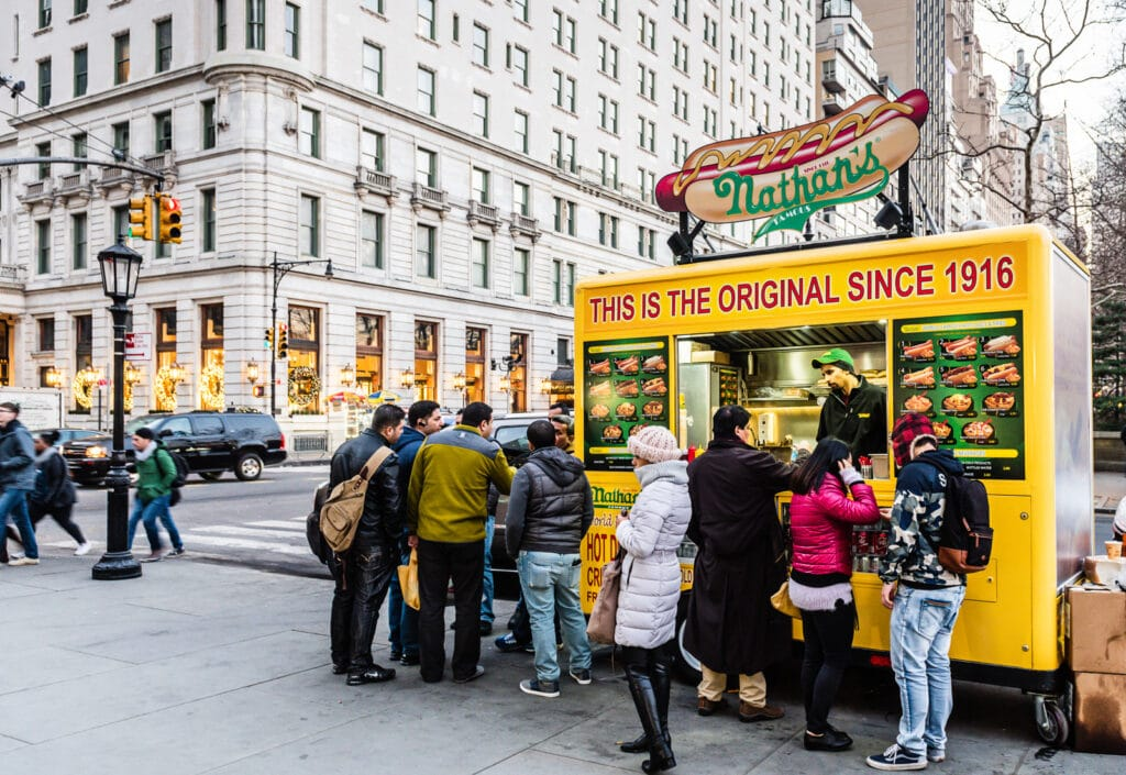Nathans Hot Dog stand at entrance to Central Park