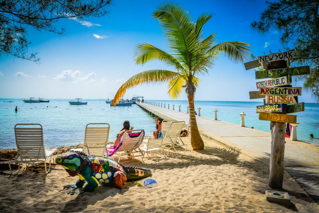 Tourists relaxing on chaise lounge at Rum Point in Grand Cayman