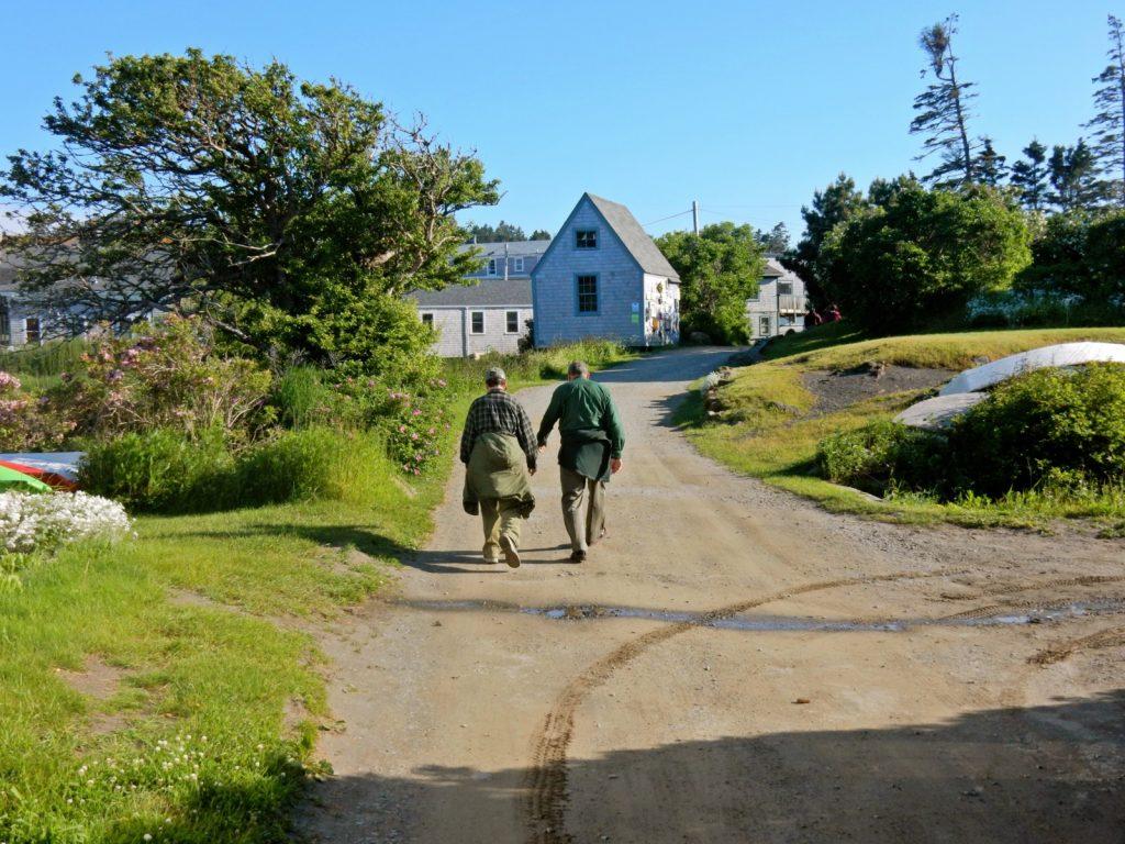 Holding hands on Monhegan Island path Maine