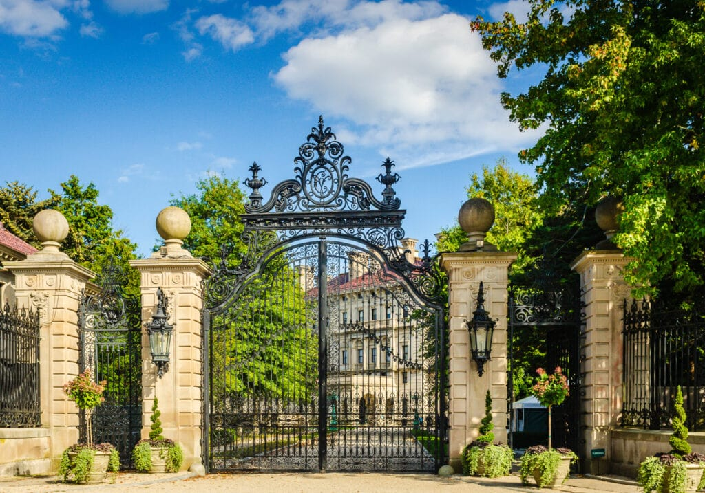 Elaborate black iron gate entrance at the Breakers Mansion in Newport RI.
