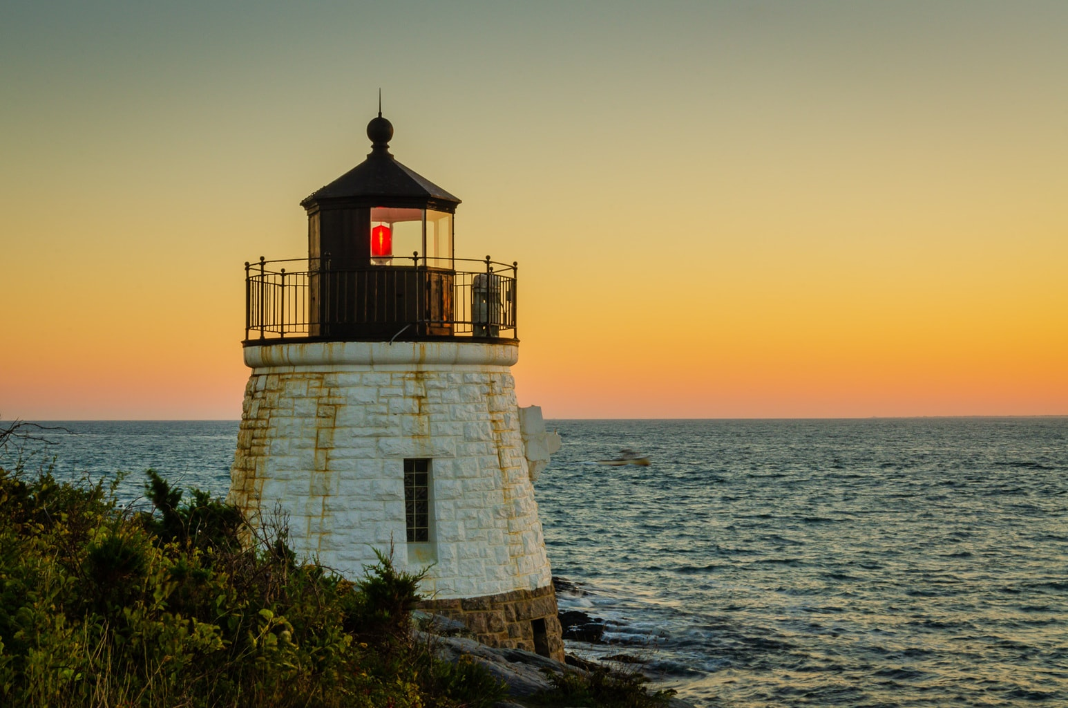 Sunset on Castle Hill Lighthouse in Newport RI.