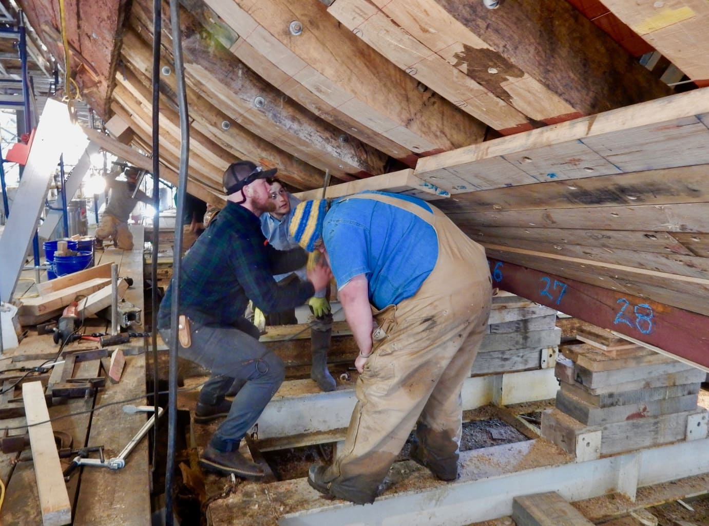 Using back-power to line up boards on Mayflower II hull, Mystic Seaport CT