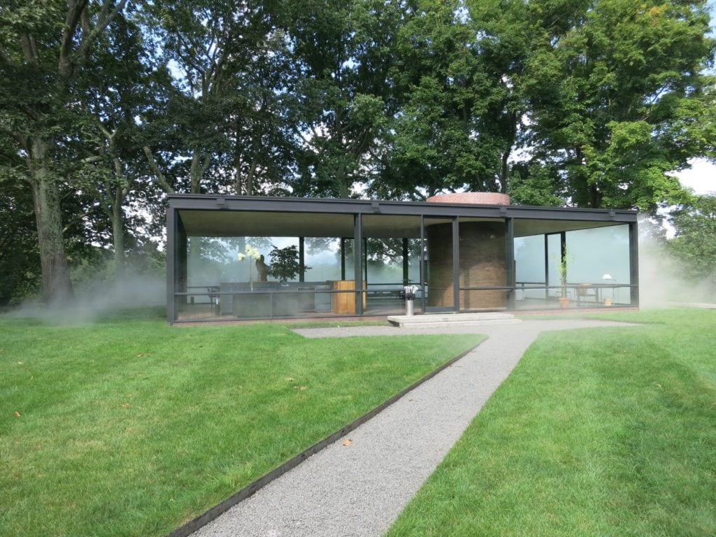 "Glass House with manmade ""mist"" art installation, New Canaan CT"
