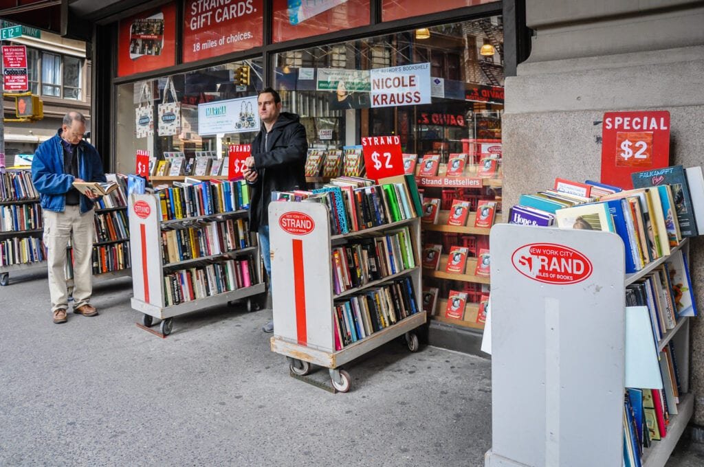 Book shelves outdoors at The Strand Bookstore.