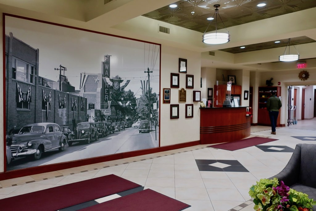 Hotel Warner lobby with photo mural of Warner Bros. Theater West Chester PA