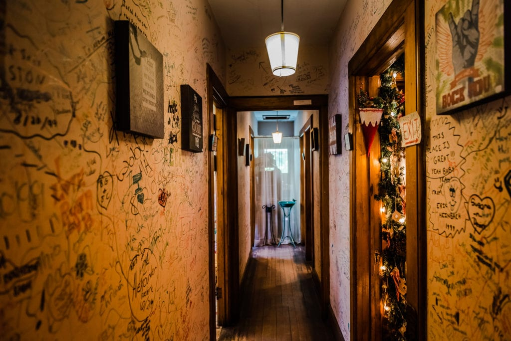 Signed hallway in the upstairs apartments of Cobbler and Co gift shop in Sharon Springs NY