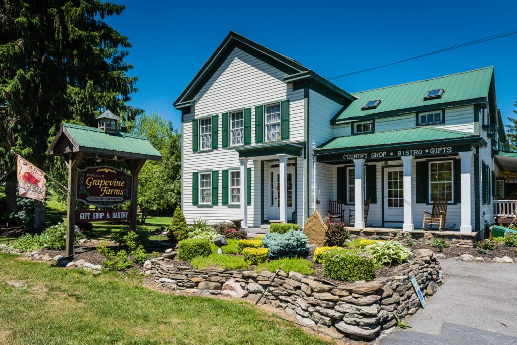 Front exterior of white farmhouse at Grapevine Farms in Schoharie NY.
