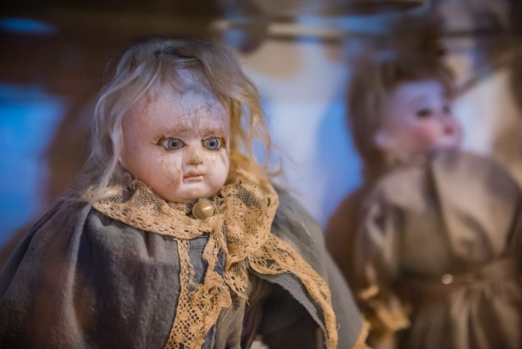 Creepy Victorian-era doll sits in display case at the Old Stone Fort Museum in Schoharie NY.