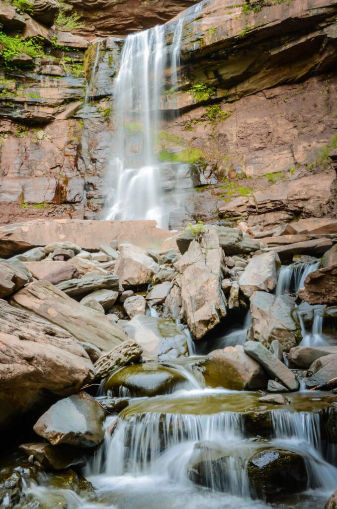 Cascading waterfall on Kaaterskill Falls trail in Catskills NY