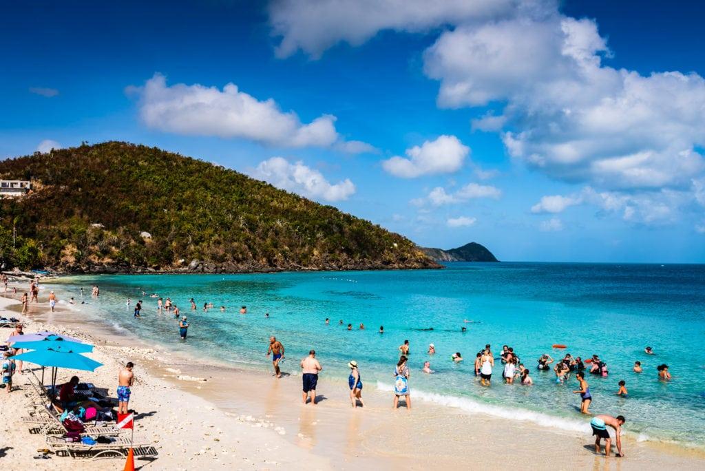 Tourists enjoying Coki Point beach in St. Thomas US Virgin Islands