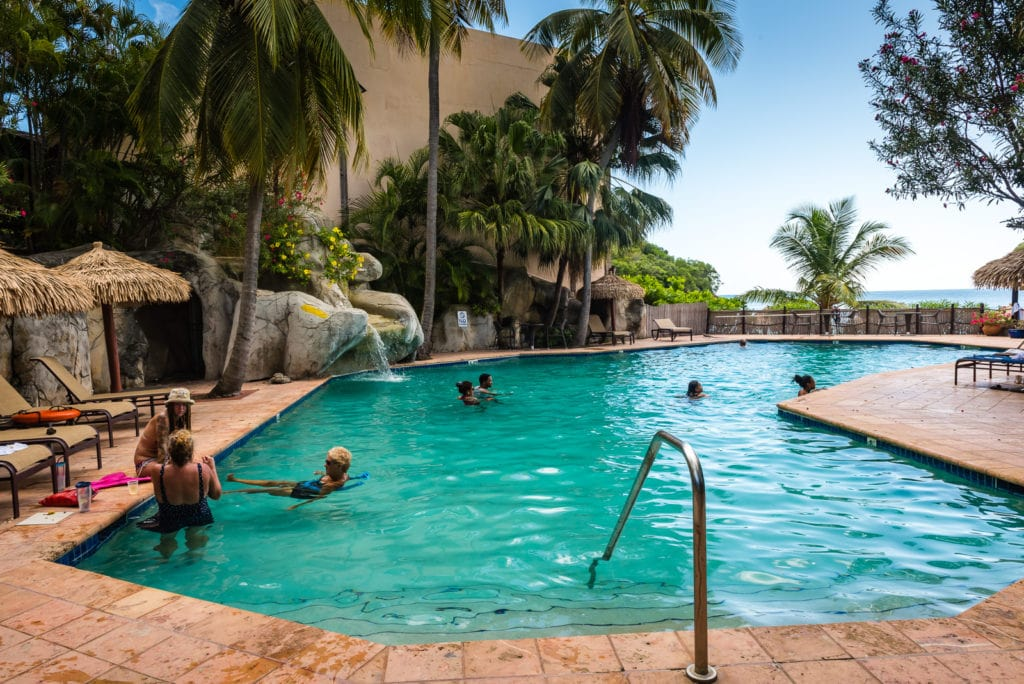 Tourists lounging by the pool at Emerald Resort in St Thomas USVI