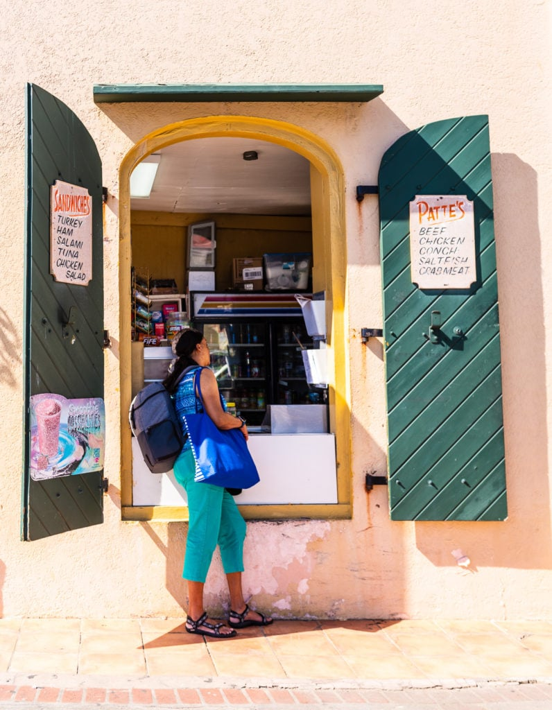 Tourist orders at the open window of the Ice Cream Shop on St. Thomas US Virgin Islands