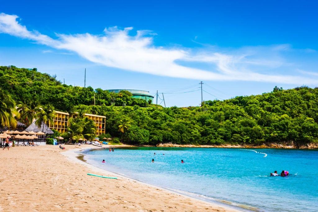 A quiet stretch of white sand beach at Lindbergh Beach in St. Thomas US Virgin Islands.